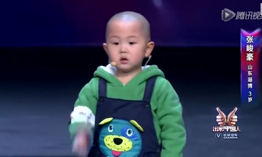 toddler performing on stage