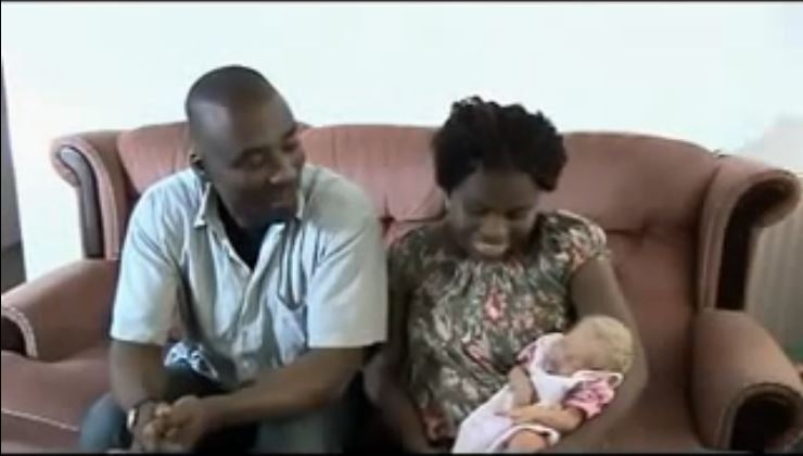 A black couple delivers to a white baby